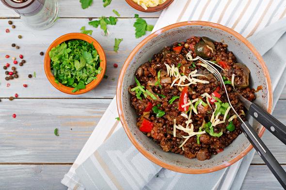 Black lentil beluga with vegetables. Lenten menu. Vegan food. Top view - Stock Photo - Images