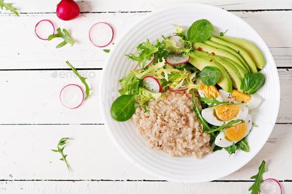 Healthy breakfast. Dietary menu. Oatmeal porridge and avocado sa - Stock Photo - Images