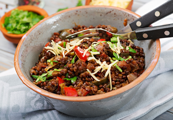Black lentil beluga with vegetables. Lenten menu. Vegan food. - Stock Photo - Images