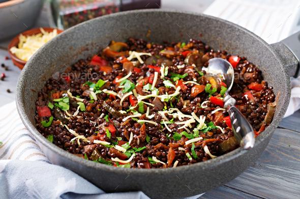 Black lentil beluga with vegetables. Lenten menu. Vegan food. - Stock Photo - Images