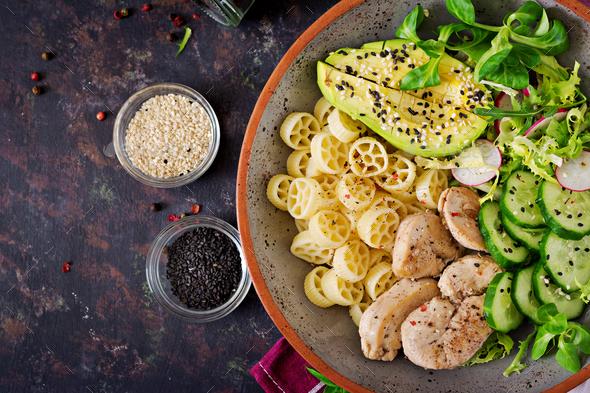 Healthy salad with chicken, avocado, cucumber, lettuce, radish  and pasta - Stock Photo - Images