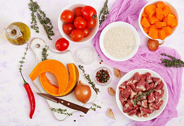 Ingredients for cooking chicken hearts with pumpkin and tomatoes in tomato sauce. - Stock Photo - Images