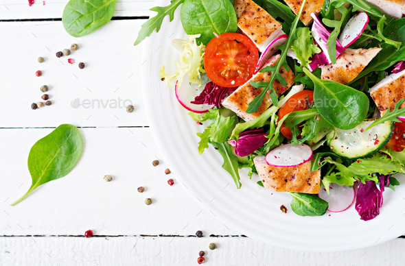 Fresh vegetable salad with grilled chicken breast   - tomatoes, cucumbers, radish - Stock Photo - Images