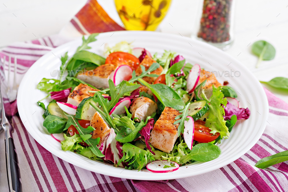 Fresh vegetable salad with grilled chicken breast   - tomatoes, - Stock Photo - Images