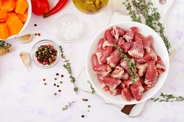 Ingredients for cooking chicken hearts with pumpkin and tomatoes in tomato sauce - Stock Photo - Images