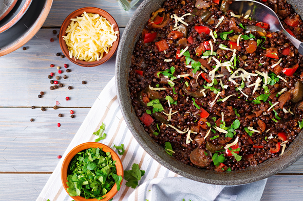 Black lentil beluga with vegetables. Lenten menu. Vegan food. Top view - Stock Photo - Images
