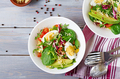 Delicious and light salad of tomatoes, eggs and a mix of lettuce leaves. Healthy breakfast. Top view - PhotoDune Item for Sale