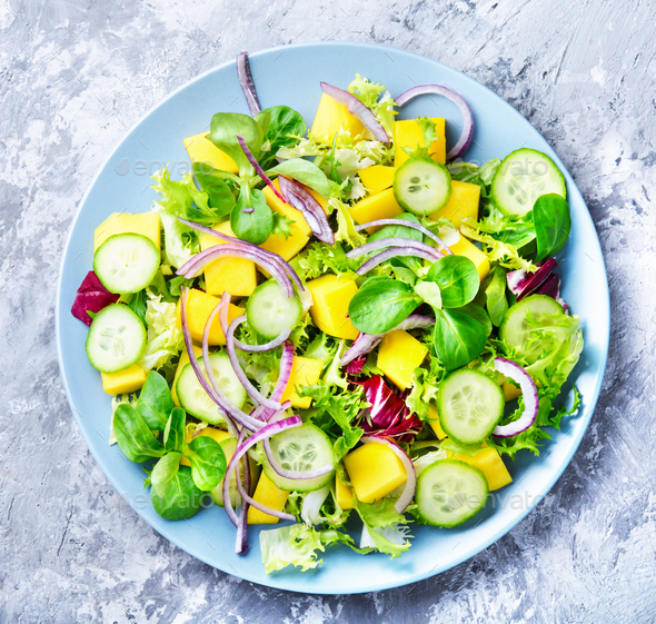 Lettuce salad with mango slices - Stock Photo - Images