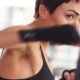 Attractive Female Boxer Training Punching a Heavy Bag in the Gym. - VideoHive Item for Sale