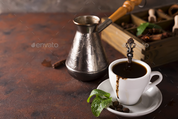 Cup of coffee with cooffee beans, wooden box with grains of coffee and spices - Stock Photo - Images
