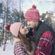 Beautiful Couple of Smiling Young People in Winter Clothes in a Snowy Forest  - VideoHive Item for Sale
