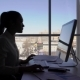 Female Silhouette Work on Keyboard Near Window in Office Room During Day. - VideoHive Item for Sale