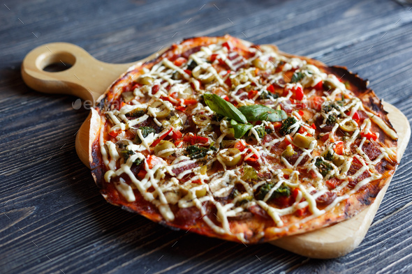 Pizza on dark wooden table - Stock Photo - Images