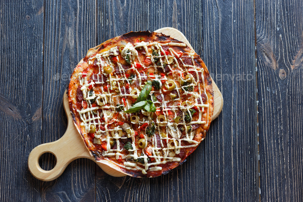 Pizza on dark wooden table. Top view - Stock Photo - Images