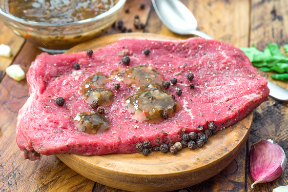 raw veal steaks on rustic wooden board - Stock Photo - Images