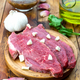 raw veal steaks on rustic wooden board - PhotoDune Item for Sale