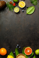 Cocktail making bar tools, tropical fruits and leaves on a dark - PhotoDune Item for Sale