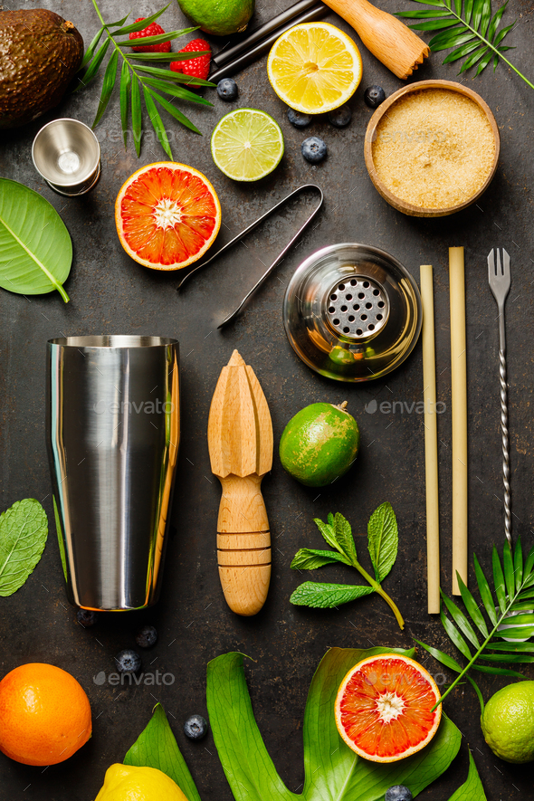 Cocktail making bar tools, shaker, tropical fruits and leaves - Stock Photo - Images