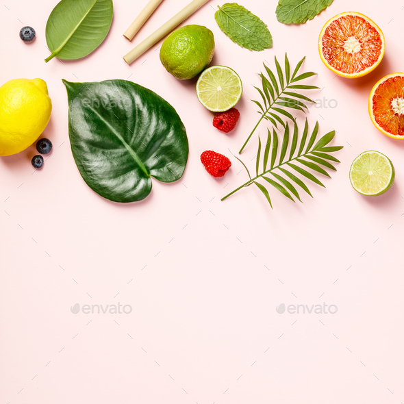 Tropical fruits and leaves on pink pastel background - Stock Photo - Images