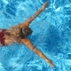 Top View of Unrecognizable Young Girl in Red Bikini Swimming Across the Pool of Hotel. Beautiful - VideoHive Item for Sale