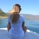 Rear Back View of Young Girl Sitting on Bow of Boat and Looking To Beautiful Nature Landscape on - VideoHive Item for Sale