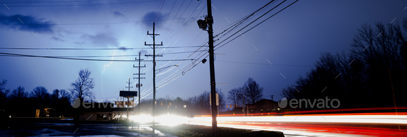 Natural Electricity Lightning Strike Behind Electrical Lines  - Stock Photo - Images