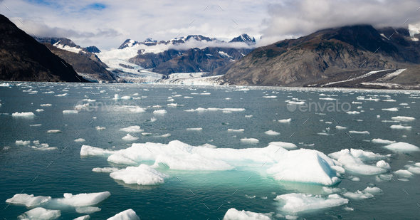 Ice Chunks Dwarfed by Mountains Aialik Glacier Alaska Kenia Fjords - Stock Photo - Images