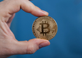 Man holding Bitcoin Cryptocurrency - PhotoDune Item for Sale