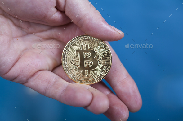 Man holding Bitcoin Cryptocurrency - Stock Photo - Images