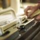 Woman Knitter Hand Working on Weaving Machine Knitting Machine Production