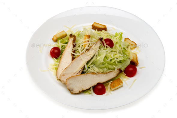 Caesar salad with chicken in a plate on a white background - Stock Photo - Images