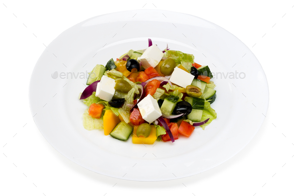 Greek salad in a white plate on a white background - Stock Photo - Images