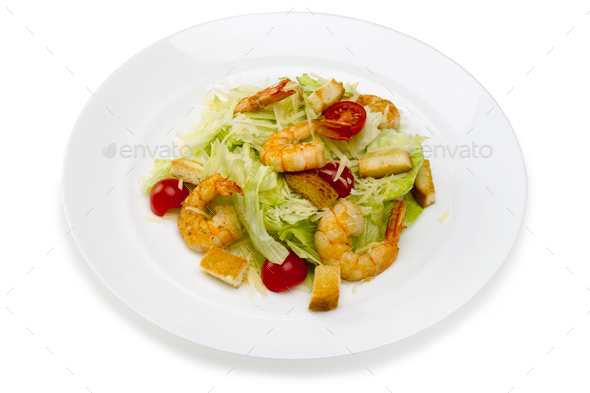 Seafood.Salad with shrimps in a plate on a white background - Stock Photo - Images