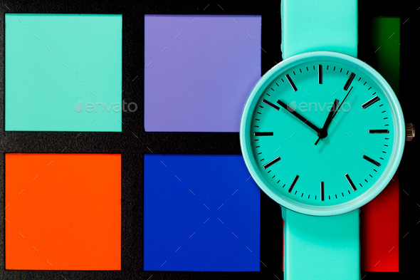 Clock on a  colored background. Abstraction. Minimalism - Stock Photo - Images