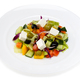 Greek salad in a white plate on a white background - PhotoDune Item for Sale