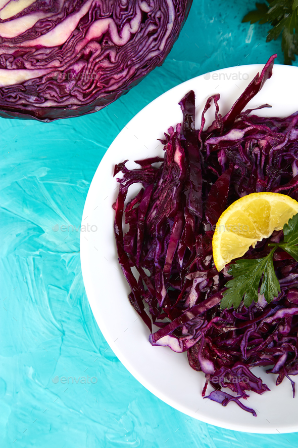 Shredded red cabbage in bowl. - Stock Photo - Images