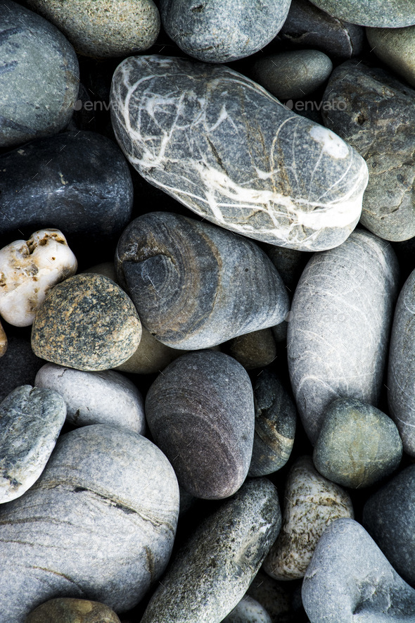 pebbles on a rock beach - Stock Photo - Images