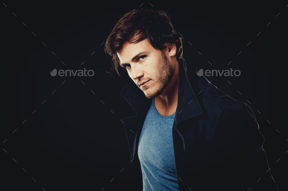 caucasian man wearing  blue tshirt, black jacket and trendy hair - Stock Photo - Images