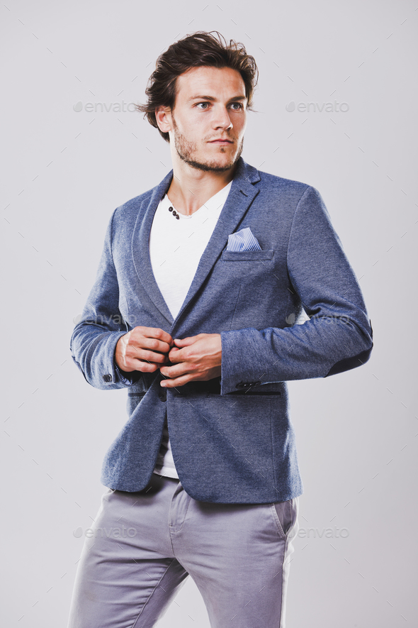 caucasian man wearing blue jacket white shirt and trendy hairsty - Stock Photo - Images