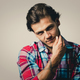 caucasian man wearing checkered shirt and trendy hairstyle - PhotoDune Item for Sale