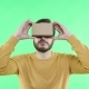 Man in Vr Glasses Enjoy on the Green Background - VideoHive Item for Sale