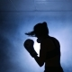 Young Woman Training with a Coach in a Boxing Club in a Smoky Gym Silhouette - VideoHive Item for Sale