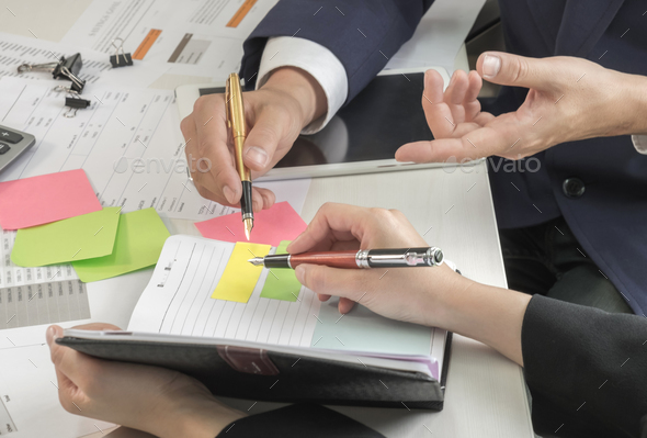 Management is executing the secretary is taking notes. - Stock Photo - Images