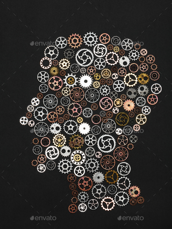 Head shape made out of little cogwheels. - Stock Photo - Images