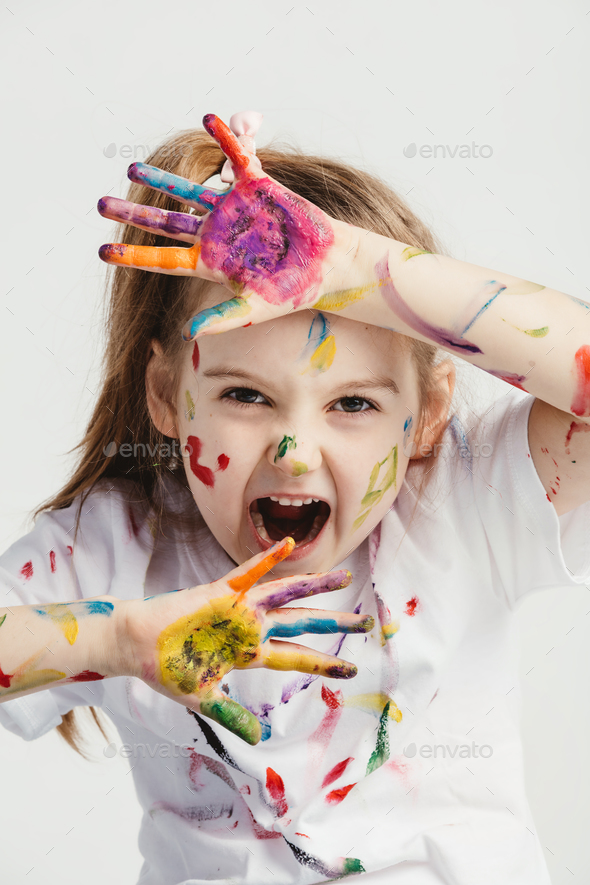 Little girl making funny faces. - Stock Photo - Images