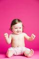 Joyful toddler on a pink background. - PhotoDune Item for Sale