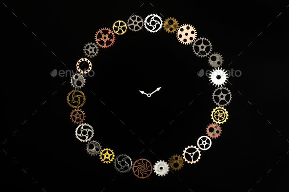 Simple clock made out of little cogwheels. - Stock Photo - Images