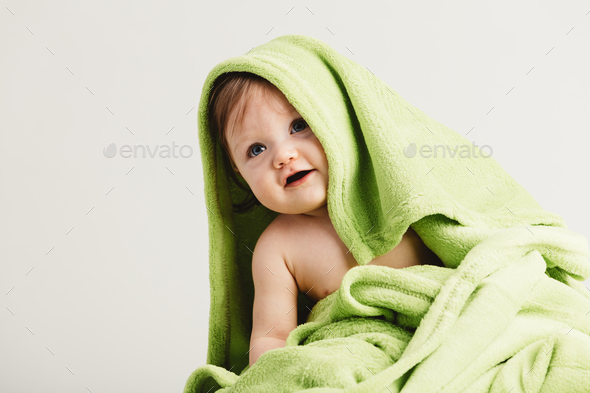 Little toddler covered in cozy blanket. - Stock Photo - Images