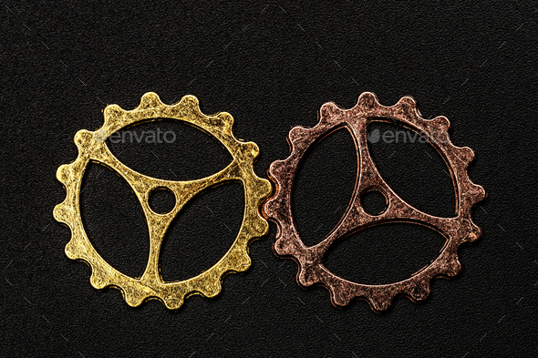 Two metal cogwheels interlocking. - Stock Photo - Images