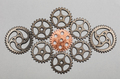 Rose-gold cogwheel and bunch of silver cogwheels - PhotoDune Item for Sale